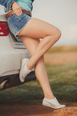 girl with beautiful legs in car