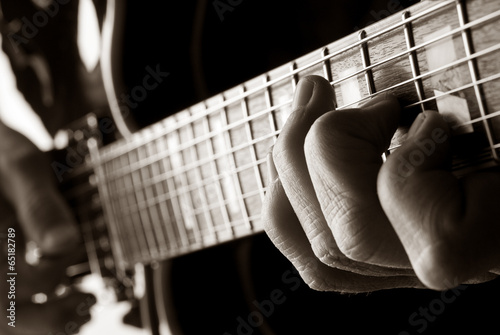 Poster playing jazz guitar