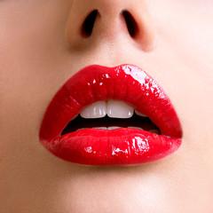 Closeup beautiful female lips with red lipstick.