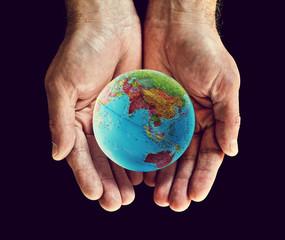 asia globe in hands