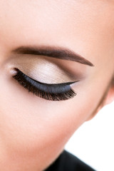 Female eye with beautiful fashion makeup.