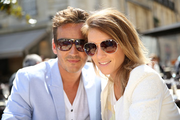 Portrait of trendy couple with sunglasses on