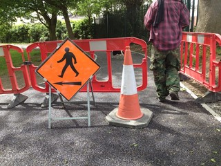 man walking through barricade