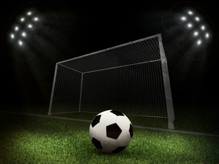 Soccer ball and gate in the middle of field