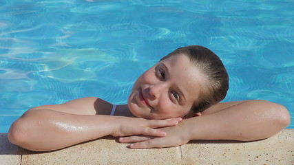 Blonde child girl in swimming pool (portrait)