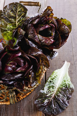 Red cos lettuce on wooden background