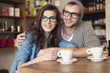 Embracing couple spending together at cafe