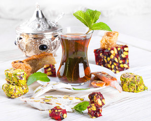 Tea in a glass with Turkish sweets