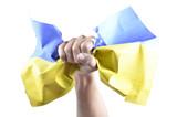 Hand grasps the Ukrainian flag poster