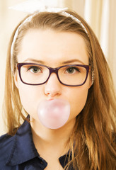 Woman at sexy suit blowing big bubble