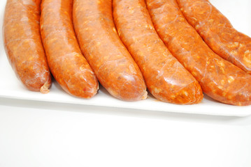 Spicy Sausage with Copy Space Isolated on White