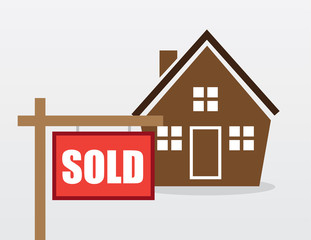 House with red sold sign outside