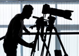 Silhouette of photographer and cameraman