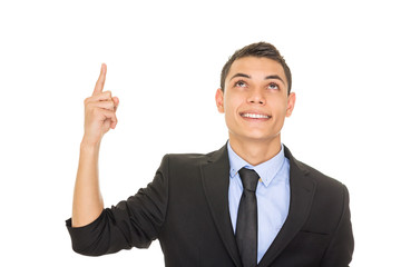 Happy young Hispanic businessman looking and pointing up