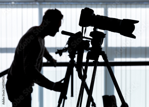 Silhouette of photographer and cameraman - 65194136