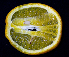 oranges -fruit rich in vitamin C on  a black  background