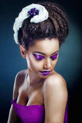 The beautiful young black girl in violet color