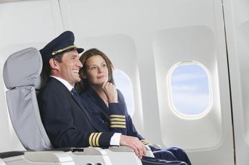 Deutschland,Bayern,München,Flugpersonal in der Business Class,lächelnd
