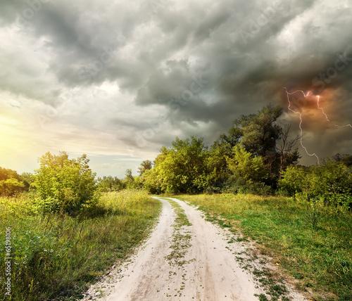 Leinwanddruck Bild Country road and thunderstorm