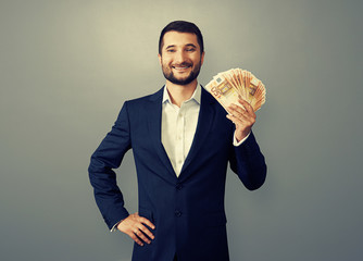 uccessful businessman holding paper money