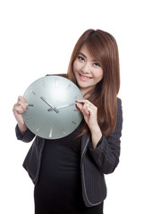 Asian Businesswoman move a clock hand and smile