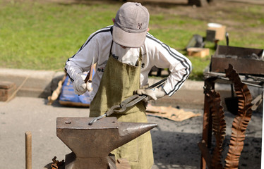Young Blacksmith working