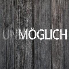 Unmögliches möglich machen Konzept-Text auf Holzboard