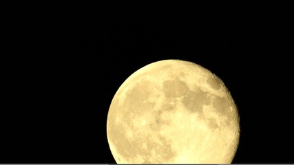 Full moon time lapse with clouds passing. 1080p