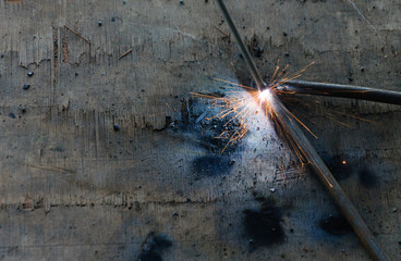 welder Welding Sparks  steel in factory
