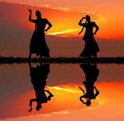 Indian dancers at sunset