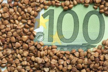 Buckwheat grains on bank note