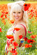 Beautiful girl on the poppy field