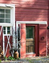 Barn Entrance with sculptural elements in afternoon light.