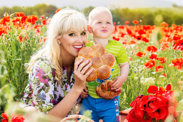 Happy mother and son on the poppies field