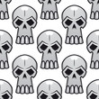 Seamless pattern of angry stylized skulls