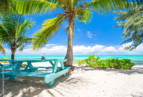 Outdoor cafe on tropical beach at Caribbean