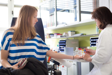 Nurse and blood donor at donation.