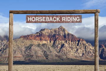 Old Horseback Riding Sign