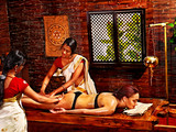 Woman having Ayurvedic spa treatment. - 65211760