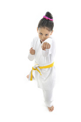 cute little girl in karate martial arts training punch attack