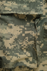 Universal camouflage pattern cargo storage pocket, acu