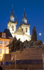 Tyn Church and statue monument Jan Hus at night Old Town Square
