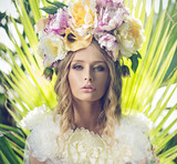 Portrait of the beautiful woman with flowery hat