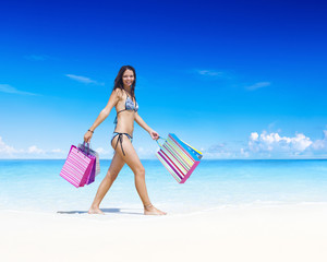 Woman with shopping bag on the beach