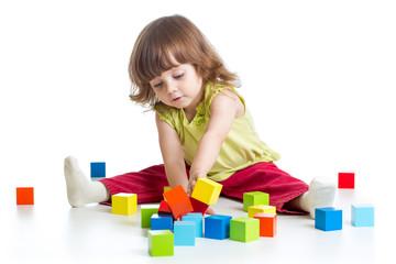 smiling kid girl playing building block toys