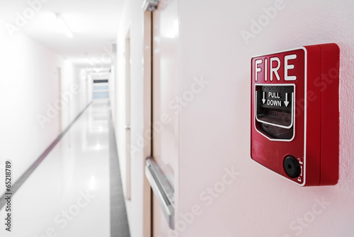 Fire Alarm near door fire exit door . - 65218789