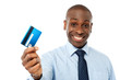 Cheerful executive holding credit card