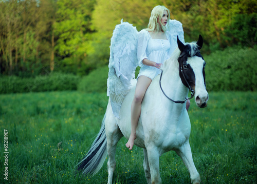 Bare feet angel riding a horse