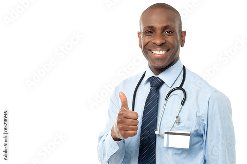 Smiling medical doctor showing thumbs up