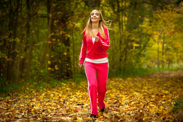 girl young woman running jogging in autumn fall forest park